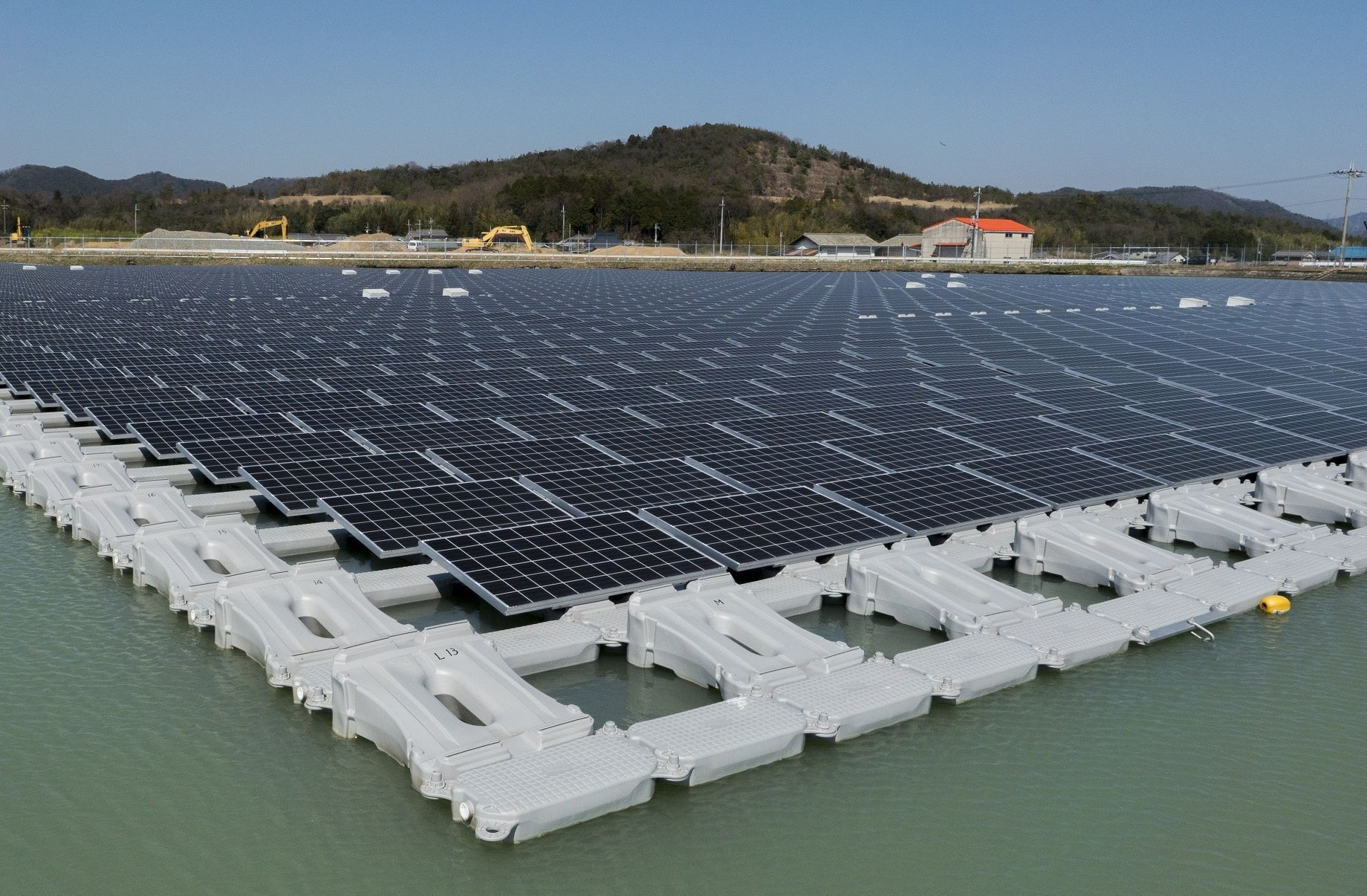 Shade balls or floating solar panels